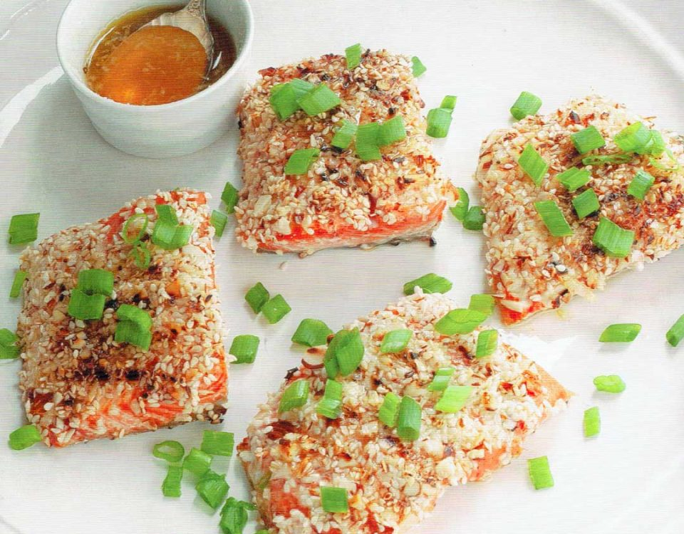 """This salmon dish is a delicious and easy way to get your recommended weekly serving of fish. It's flaky and tender, and it has a fantastic almond and sesame flavor. A simple sauce finishes it off without being too sweet or overpowering. If you are new to eating fish, this is a great """"starter"""" recipe because it only takes 10 minutes to cook and salmon is generally mild in flavor."""