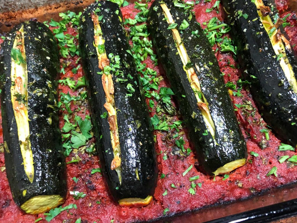 Cretan Roasted Zucchini In this traditional Cretan recipe, the zucchini is stuffed with garlic and then oven-roasted with tomatoes, parsley, and olive oil. This delicious recipe is simple to make.