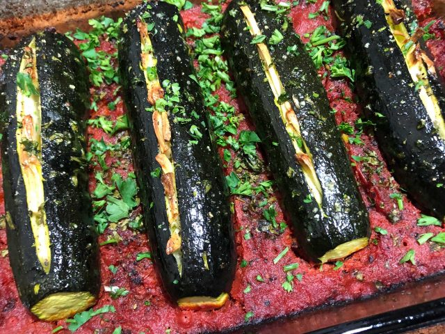 Cretan Roasted Zucchini: In this traditional Cretan recipe, the zucchini is stuffed with garlic and then oven-roasted with tomatoes, parsley, and olive oil. This delicious recipe is simple to make.