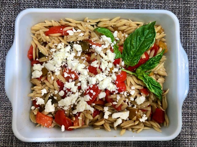 Orzo with Feta and marinated Peppers This orzo salad is full of flavor, with balsamic-marinated peppers that are paired perfectly with tangy, peppery teta cheese. lt' s an ideal salad for a work lunch or a picnic.