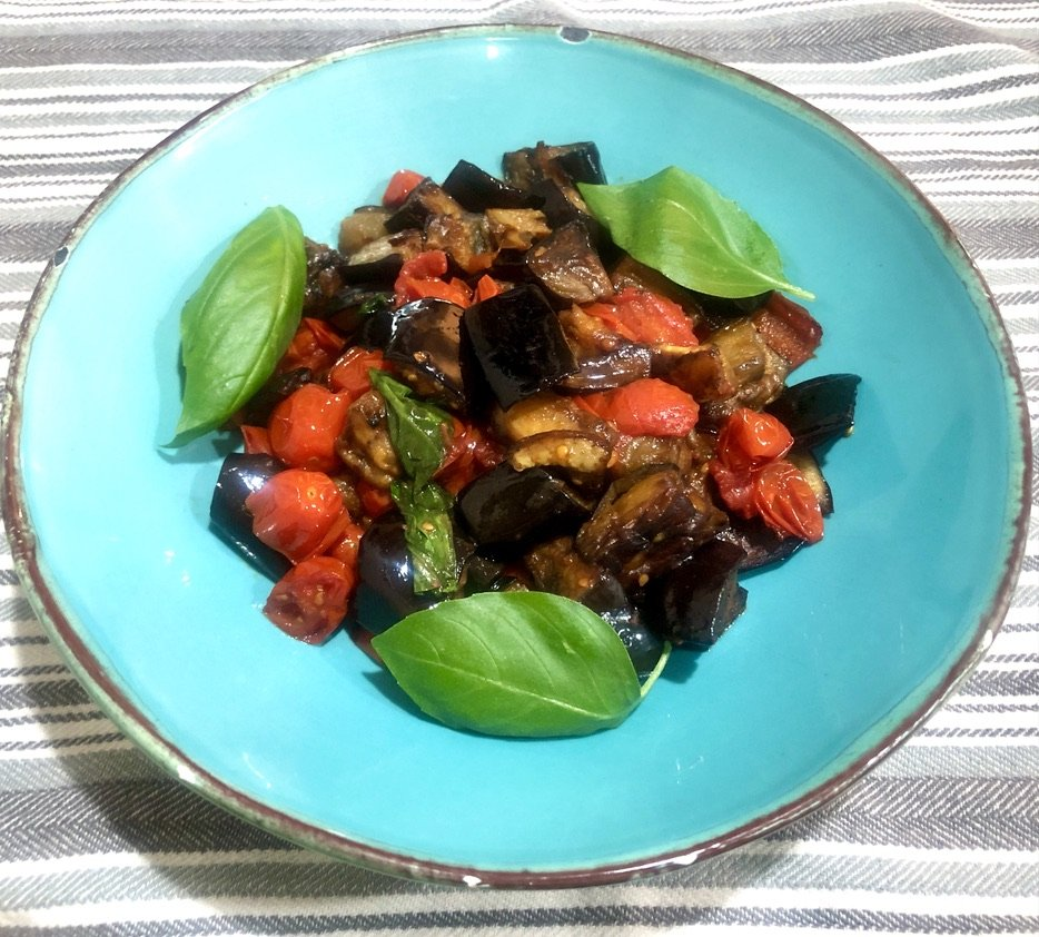 """The eggplant, which is cooked """"mushroom style"""" in a light tornato and basil sauce, has a buttery quality that melts in your mouth."""